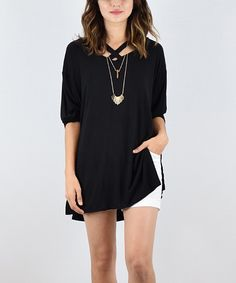 A strappy crisscross neckline caps this comfortably relaxed tunic with an edgy, streetwise flourish. 95% rayon / 5% spandexHand washMade in the USA