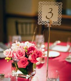 Pink table linens and centerpieces