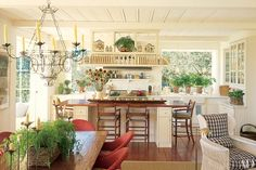 The island in architect Howard J. Backen's sunny Napa Valley, California, kitchen doubles as a work space and a gathering spot.