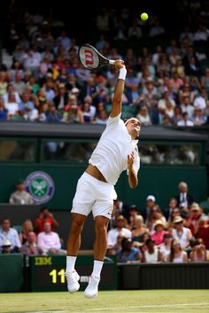 Roger Federer Photos Photos - Roger Federer of Switzerland serves during the Gentlemen's Singles first round match against Alexandr Dolgopolov of Ukraine on day two of the Wimbledon Lawn Tennis Championships at the All England Lawn Tennis and Croquet Club on July 4, 2017 in London, England. - Day Two: The Championships - Wimbledon 2017