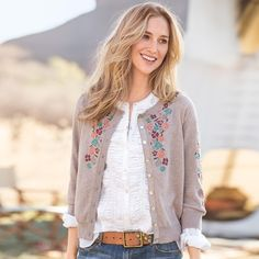 """CADENCE OF FLOWERS CARDIGAN--Loveliness abounds in our embroidered jersey knit cotton cardigan, with needlework winding down front, sleeve and back neckline. Rib trim, ribbon placket and shell buttons. Hand wash. Imported. Exclusive. Sizes XS (2), S (4 to 6), M (8 to 10), L (12 to 14), XL (16). Approx. 21-1/2""""L."""
