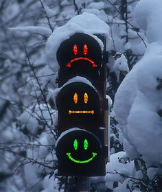Stoplight Faces, in Switzerland  --         We're happy when we get the green smiley face!