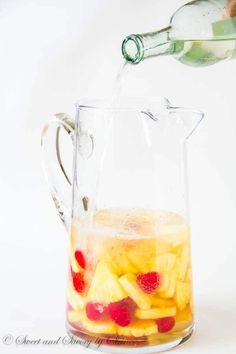 Light and refreshing, this pineapple raspberry sangria is a fun and colorful summer drink for a crowd. Only 5 ingredients required!