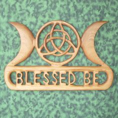 (For S.) Triple Moon Blessed Be with Triquetra Wiccan Greeting Celtic Wood Carving. $138.00, via Etsy.