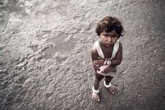 In India you'll most likely come across small children begging for money. Some people give them some change or food, others argue in the long run it's better not to give anything at all to avoid encouraging begging.   What would you do?