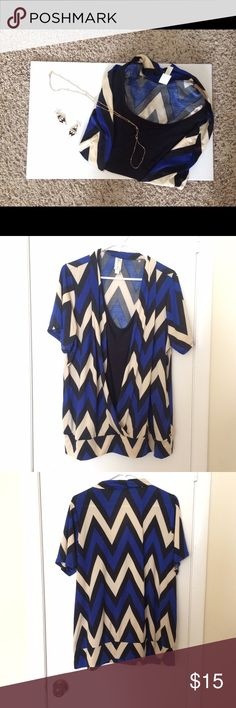 Women's Dress Top Brand new Women's Dress Top (NWOT). Is a size 3X. Has a beautiful Chevron patterned Blue, Nude, and Black strip. Is in excellent condition. Would be great for a date night out, or as a nice blouse for work. Price is negotiable. Thank you.☺️ ❌No Trades❌ Tops Blouses