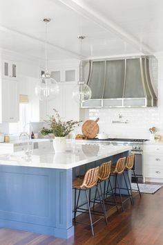 Traditional kitchen design inspiration, bright and airy home, blue kitchen island, silver chrome range hood, kitchen sink design | Studio McGee Blog