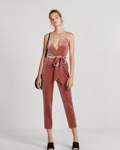 "You'll absolutely sizzle in this jumpsuit thanks to a deep v-neck, smooth velvet and a curve-hugging fit. Pair with heels for a sexy all-in-one outfit. Designed to fit and flatter your 5'4"" and under frame."