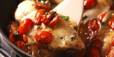 Tomatoes cooked in balsamic vinegar are the perfect sweet-tart compliment to this cheesy chicken.
