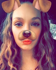 Maddie Ziegler, 14 years old using the dog filter on Snapchat to take a cute selfie