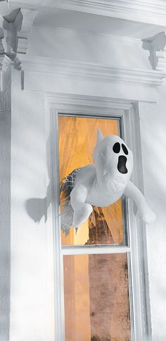 Take your spooky décor to a whole new dimension, with Window Crasher Ghosts that appear both inside and outside your house!