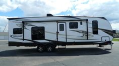 """STRAPPING TOY HAULER!!!  2017 Heartland Torque XLT T29 The fuel and oil resistant flooring in the garage will make cleanup a snap! Close off the electric rear screen to let in the breeze and keep the bugs out! This rig is 34' 5"""" long with a 12' garage! With a shipping weight of 7,785lbs and a GVWR of 9,999lbs, you can haul around 2,214lbs of cargo & toys!  Give our Torque XLT expert Norman Wells a call 231-730-3481 for pricing and more information!"""