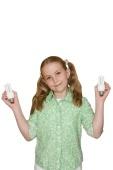 21576 Girl holding energy saving light bulbs cut out