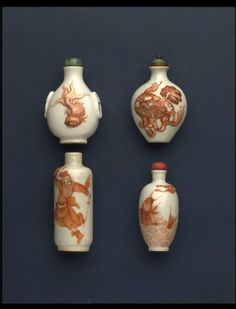 [Snuff bottle] Porcelain, with moulded relief decoration painted in red and black [Stopper] Turquoise set in gilded metal