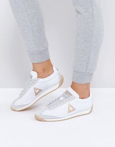 Buy it now. Le Coq Sportif Quartz Trainers - White. Trainers by Le Coq Sportif, Leather and textile upper, Lace-up design, Branded tongue and cuff, Padded for comfort, Signature logo to side, Chunky sole, Textured tread, Wipe with a damp cloth, 90% Textile, 10% Real Leather Upper. Founded in 1882 by Emile Camuset, Le Coq Sportif's collection of vintage-inspired running shoes and plimsolls has a simple, timeless aesthetic. Drawing on more than 125 years of experience, its collection of suede…