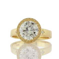 Brides.com: . Style gr216, 2 ct bead set ring, price upon request, Adel Chefridi  See more round-cut engagement rings.