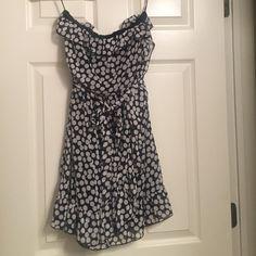 Strapless polka dot mini dress Fun little black with white polka dot strapless mini dress. Never worn. Size medium but fits like a small. Dresses Mini