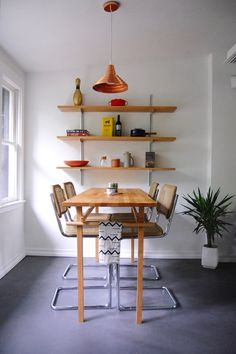 A custom-built table can be a huge solution to an odd shaped or sized room but it doesn't have to break the bank. This custom table uses an IKEA counter top as the surface - easy and totally affordable!