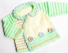 Original hand-knitted baby sweater  with crocheted flowers