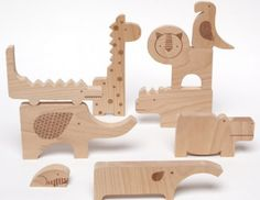 Petit Collage's Safari Animal Wooden Jumble doubles as a puzzle and a playset