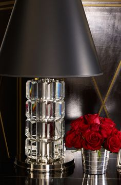 Vibrant red roses make for a romantic yet masculine bouquet in a Ralph Lauren Home bedroom