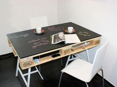 Ingenious palette, painted chalkboard table using saw horses! Wow. Brandy Knight table