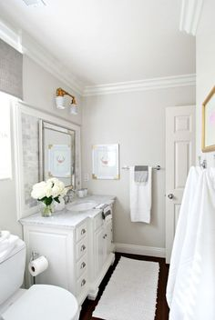 A neutral palette for the washroom. Wall color:Pale Oak by Benjamin Moore.