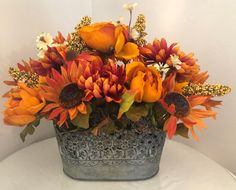 Artificial flower arrangement in tin pot farmhouse decor floral arrangement yellow and orange autumn decor Blumensträusse Gestecke ! Funeral Flower Arrangements, Fall Floral Arrangements, Artificial Flower Arrangements, Artificial Flowers, Flower Arrangements In Baskets, Halloween Flower Arrangements, Outdoor Flowers, Autumn Decorating, Orange