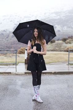 The scenery is amazing, love the rain boots  with classic black umbrella but I would have to ditch the jumper.