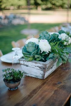 Love the cabbage-looking plants in this rustic centerpiece | See more on SMP: http://www.StyleMePretty.com/2014/02/05/casual-walnut-orchard-wedding/ Abi Q Photography