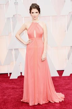 Anna Kendrick showed up to the red carpet wearing a stunning coral gown with peek-a-boo cutout at the bust. Description from delicabridal.com. I searched for this on bing.com/images