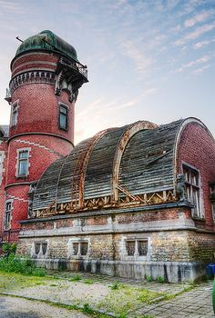 The Victorian Cointe Observatory in Liège, Belgium designed by Lambert Noppius and built in 1881-1882. Space observatories are among some of the most magnificent buildings devoted entirely to science — because their windows look out on the universe and their distinctive shape makes them into poignant ruins. Abandoned in 2002. http://en.wikipedia.org/wiki/Cointe_Observatory