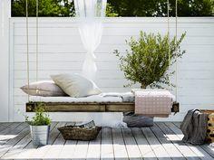 Rustic outdoor living, hanging wooden swing