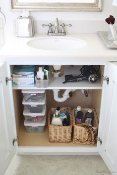 a shelf (that has cut out for pipes) for storage under a bathroom sink