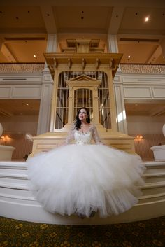 This beautiful Disney bride at Walt Disney World looks like royalty with her full tulle wedding gown. Photo: Stephanie, Disney Fine Art Photography