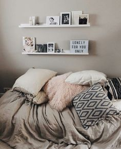 Shelving above the bed.