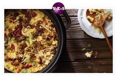 1 pkg. (26-32 oz) frozen shredded hash browns  1 pkg. sausage  2 cups shredded mozzarella cheese  1/2 cup shredded parmesan cheese  1/2 cup julienne-cut sun dried tomatoes  6 green onions  12 eggs  1/2 cups milk  1/2 teaspoon salt  1/4 teaspoon ground black pepper