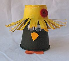 Plastic Cup Crow To make this bird, paint one plastic cup black and another yellow. Attach an orange craft foam triangle to the black cup for the beak and a heart shape for the feet.  Once the yellow cup is dry, cut thin slits all the way around the cup like fringe. Bend the fringe upward to form a hat. Glue two cotton balls inside the hat cup before gluing it onto the top of the inverted black cup. Add two googly eyes to the bird and a red button to his hat.