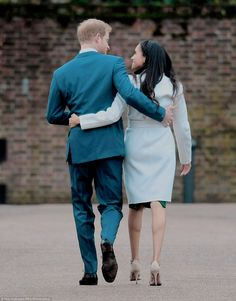 Prince Harry & Meghan Markle during an official photocall to announce their engagement at The Sunken Gardens at Kensington Palace. | 27 November 2017
