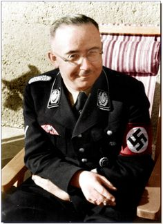 An oddly smiling Heinrich Himmler on the veranda at the Berghof