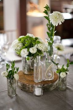 Wedding reception help - Ornament your wedding reception with these amazing, inexpensive ideas. Should you be looking for wedding reception ideas, you have found them here. With our collection of wedding reception samples, you need look no more. Find now. Wood Slab Centerpiece, Rustic Centerpieces, Flower Centerpieces, Wedding Centerpieces, Wedding Table, Flower Arrangements, Rustic Wedding, Wedding Decorations, Table Decorations