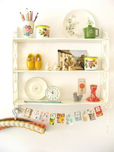 Love these types of things! I also love the decor at the bottom and the vintage tins and plates on the shelves!  Dining room, maybe?