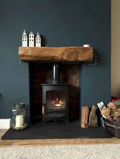 Fireplace Finished Charnwood C-Four Riven Such a cosy fireplace with a slate hearth, exposed brick & rustic oak beam. Love the dark blue wall and home accessories, too! Style At Home, My Living Room, Home And Living, Dark Blue Living Room, Log Burner Living Room, Cottage Living Room Decor, Dark Blue Lounge, Cozy Living Room Warm, Kitchen Living