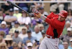 Cincinnati Reds' Joey Votto drives in a run with a single against the Colorado Rockies during the fifth inning of a spring training baseball game