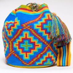 Cabo Wayuu Mochila bags are intricate in their designs, can take approximately 15 -20 days to weave. Hand Woven Strap.   Handmade in South America by the indige