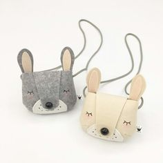 Gorgeous grey and cream rabbit handbags.Designed and made by Naive in Korea.