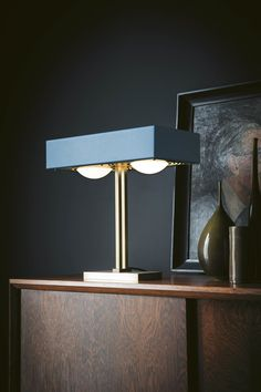 Kernel Table Lamp in Matte Petrol Blue by British lighting brand Bert Frank. The solid brass base and angular form of this table lamp is softened by the warm glow of opal glass globes and the unexpected detailing in the brass diffuser and highlights. Luxury Lighting, Interior Lighting, Interior Styling, Lighting Design, Lighting Ideas, Bauhaus, Designer Hotel, Crystal Lights, Luminaire Design