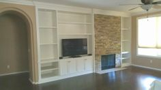 A living room wall was transformed with this custom cabinet and stacked rock fireplace wall. #ranchointeriordesign.com Repin it.