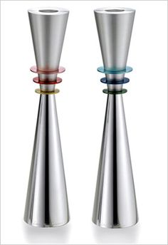 ADAM AND EVE CANDLESTICKS: The Shabbat Candlesticks are inspired by the seven days of creation. This elegant minimalist pair of candlesticks represents Adam and Eve. Each piece is expertly turned from solid aviation quality aluminum. The contrasting finishes on the candlesticks reflect the opposites of day and night, heaven and earth, sea and land. The six discs represent the 6 days of the week prior to the Jewish day of rest, the Shabbat.  www.lauracowan.com