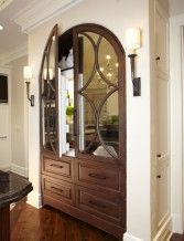 Love the way these appliance panels were mirrored and arched to disguise the refrigerator! Genius!!!